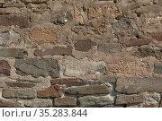 Stony wall of medieval castle close up, authentic stonework for texture or background, masonry cobblestones and stones. Стоковое фото, фотограф Андрей Копылов / Фотобанк Лори