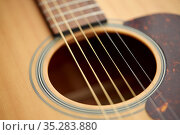 close up of acoustic guitar strings. Стоковое фото, фотограф Syda Productions / Фотобанк Лори