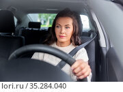 woman or female driver driving car in city. Стоковое фото, фотограф Syda Productions / Фотобанк Лори