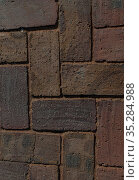 Paved aged bricks pavement of dark red-brown stones, close-up top view above of cobblestones for background or texture. Стоковое фото, фотограф Андрей Копылов / Фотобанк Лори