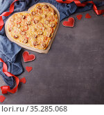 Heart shaped pipperoni pizza for Valentine's Day on black background. Top view. Place for your text. Стоковое фото, фотограф Сергей Молодиков / Фотобанк Лори