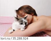 Sleeping beautiful girl hugs a cute white cat. Pink bed linen, white background. Стоковое фото, фотограф Кристина Сорокина / Фотобанк Лори