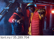 Two rappers with gold jewelry in cool studio. Стоковое фото, фотограф Tryapitsyn Sergiy / Фотобанк Лори