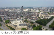 Panoramic aerial view of modern cityscape of Nantes on banks of Loire river on summer day, France. Стоковое видео, видеограф Яков Филимонов / Фотобанк Лори
