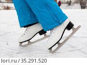 Female person standing on toes in figure skates on lake ice, close-up view. Стоковое фото, фотограф Кекяляйнен Андрей / Фотобанк Лори