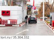 Saratov, Russia - 11/01/2020: Lukoil fuel station, the car is refueled with gasoline, petrol. Редакционное фото, фотограф Светлана Евграфова / Фотобанк Лори