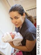 Caucasian mother holding hands newborn baby, Caucasian female. Стоковое фото, фотограф Кекяляйнен Андрей / Фотобанк Лори