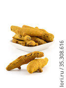 Dry Turmeric roots or barks in white plate isolated on white background... Стоковое фото, фотограф Dipak Chhagan Shelare / easy Fotostock / Фотобанк Лори