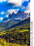 Grassy slope of the mountain and wall of jagged rocks. Italy. Rural... Стоковое фото, фотограф Zoonar.com/kavram / easy Fotostock / Фотобанк Лори