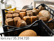 Freshly baked bread in crate in bakery. Стоковое фото, фотограф Яков Филимонов / Фотобанк Лори