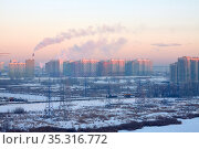 High voltage towers with electrical wires on residential buildings background. Стоковое фото, фотограф Азат Хайрутдинов / Фотобанк Лори