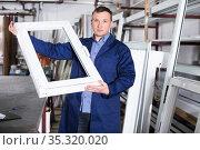 Labours with finished PVC profiles. Стоковое фото, фотограф Яков Филимонов / Фотобанк Лори
