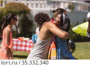 Diverse group of friends greeting each other at a pool party. Стоковое фото, агентство Wavebreak Media / Фотобанк Лори