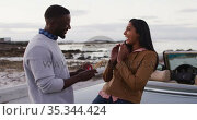 African american man proposing his girlfriend with a ring near the convertible car on the road. Стоковое видео, агентство Wavebreak Media / Фотобанк Лори
