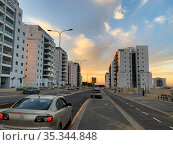 New Sigaliyot district in Beer Sheva in the evening against the backdrop of a beautiful sunset. Редакционное фото, фотограф Irina Opachevsky / Фотобанк Лори