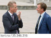 Iffezheim, Germany, Jan Pommer lawyer and sports manager, (left) talking with Gerhard Schoeningh, owner of Hoppegarten racecourse. Редакционное фото, агентство Caro Photoagency / Фотобанк Лори