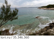 Croatia, Prementura - Swell in a bay in the nature reserve Cape Kamenjak, at the southern tip of Istria (2016 год). Редакционное фото, агентство Caro Photoagency / Фотобанк Лори