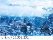 French village in snow, old church cloud covered (2020 год). Стоковое фото, фотограф Сергей Новиков / Фотобанк Лори