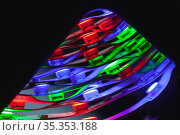 Rolled LED strip lights glow in the dark, close up. Стоковое фото, фотограф EugeneSergeev / Фотобанк Лори