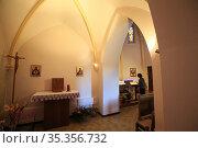 Pilgrim lighting candles. Church of the Marian Shrine of BŽnite Fontaine... Стоковое фото, фотограф Catherine Leblanc / easy Fotostock / Фотобанк Лори