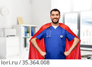 smiling doctor or male nurse in superhero cape. Стоковое фото, фотограф Syda Productions / Фотобанк Лори