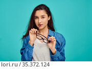 Attractive mysterious woman holds glasses, emotion. Стоковое фото, фотограф Tryapitsyn Sergiy / Фотобанк Лори