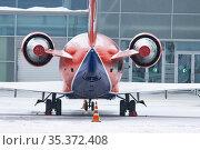 A colorful airplane on the airfield from the back. Стоковое фото, фотограф Константин Шишкин / Фотобанк Лори