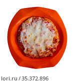 Small pizza with cheese and sausages from childrens menu. Стоковое фото, фотограф Яков Филимонов / Фотобанк Лори
