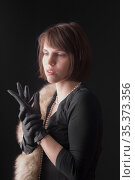 Studio portrait of a woman in gloves. Стоковое фото, фотограф Argument / Фотобанк Лори