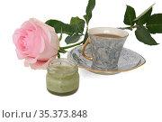 Cup of black coffee, pistachio honey-souffle and beautiful pink rose on white background. Подарок для любимой. Стоковое фото, фотограф Валерия Попова / Фотобанк Лори