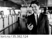 Portrait of young handsome businessman in suit exploring the city... Стоковое фото, фотограф Zoonar.com/Toni Rantala / easy Fotostock / Фотобанк Лори