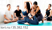 Panoramic Asian people learning Yoga class in fitness club. Instructor... Стоковое фото, фотограф Zoonar.com/Vichie81 / easy Fotostock / Фотобанк Лори