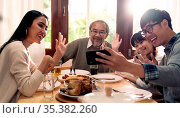 Happy asian multigenerational family of dad mom daughter girl and... Стоковое фото, фотограф Zoonar.com/Vichaya Kiatying-Angsulee / easy Fotostock / Фотобанк Лори