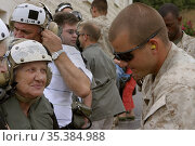 LEBANON Beirut -- 21 Jul 2006 -- Americans don air crew cranials ... Редакционное фото, фотограф Jonathan William Mitchell / age Fotostock / Фотобанк Лори