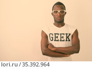 Studio shot of young African man as nerd with eyeglasses against white... Стоковое фото, фотограф Zoonar.com/Toni Rantala / easy Fotostock / Фотобанк Лори