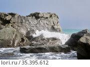 Sea surf between coastal rocks with seagulls sitting on them. Стоковое фото, фотограф Евгений Харитонов / Фотобанк Лори