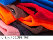 Colorful fleece clothes, close up photo. Стоковое фото, фотограф EugeneSergeev / Фотобанк Лори