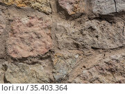 Old brick wall of rough stone. Стоковое фото, фотограф Юрий Бизгаймер / Фотобанк Лори
