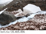 Melting water flowing from mountains between glaciers and snow. Khibiny, Kola peninsula, Russia. Стоковое фото, фотограф Кекяляйнен Андрей / Фотобанк Лори