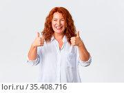 Good job, nice work gesture. Portrait of pleased smiling redhead middle... Стоковое фото, фотограф Zoonar.com/Seva Levitsky / easy Fotostock / Фотобанк Лори