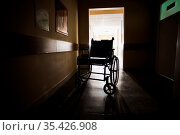 Silhouette of an empty wheelchair that standing in the middle of a... Стоковое фото, фотограф Zoonar.com/OKSANA SHUFRYCH / easy Fotostock / Фотобанк Лори