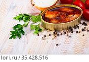 Stuffed squid in tomato sauce on background with greens, tomatoes. Стоковое фото, фотограф Яков Филимонов / Фотобанк Лори