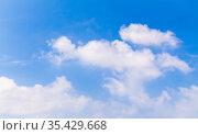 Natural background photo of blue sky with white cumulus clouds. Стоковое фото, фотограф EugeneSergeev / Фотобанк Лори