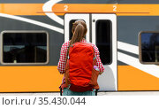 young woman with backpack traveling over train. Стоковое фото, фотограф Syda Productions / Фотобанк Лори