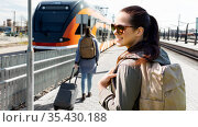 woman with backpack traveling by train in estonia. Стоковое фото, фотограф Syda Productions / Фотобанк Лори