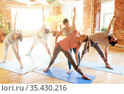 group of people doing yoga exercises at studio. Стоковое фото, фотограф Syda Productions / Фотобанк Лори