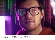 man in glasses over neon lights and binary code. Стоковое фото, фотограф Syda Productions / Фотобанк Лори