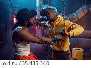 Two rappers posing, performing in studio. Стоковое фото, фотограф Tryapitsyn Sergiy / Фотобанк Лори