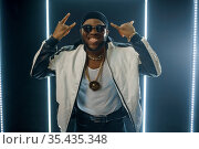 Smiling rapper on the stage with illuminated cube. Стоковое фото, фотограф Tryapitsyn Sergiy / Фотобанк Лори
