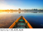 Fishing boat at foggy sunrise on a lake. Стоковое фото, фотограф Sergey Borisov / Фотобанк Лори